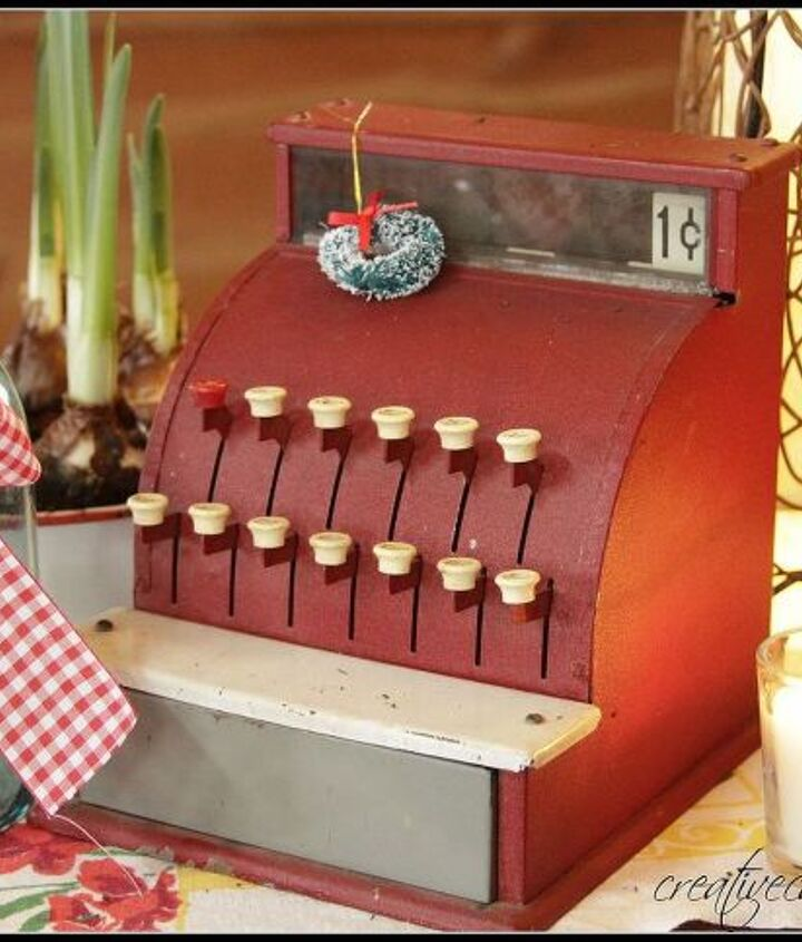 woody pillow and a vintage cash register, seasonal holiday decor