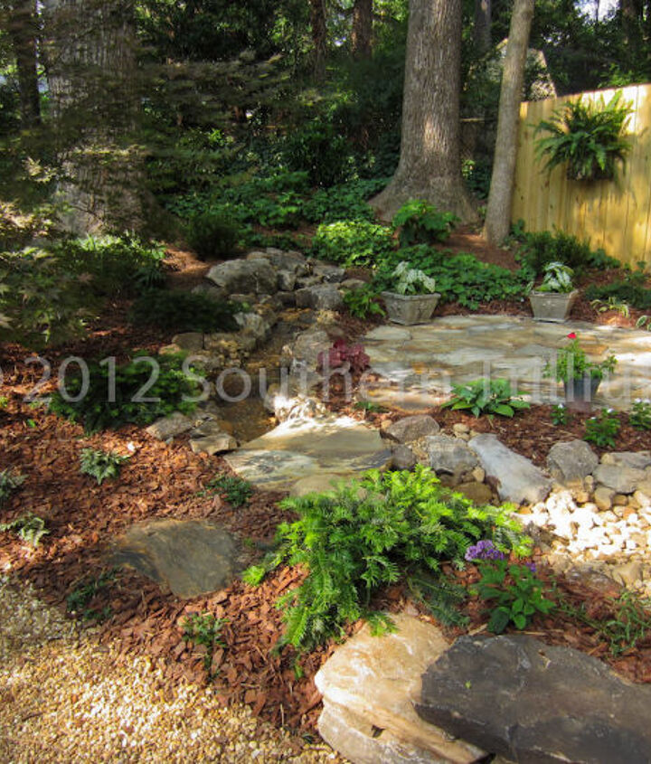 The newly installed sitting area with the pondless water feature.