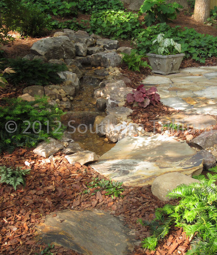 A different view of the stream running along the sitting area.