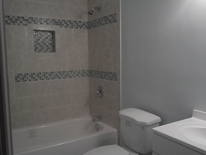 AFTER~ The finished project--- painted walls a light blue.  All tile bought at Home Depot.  Actually, I think all but the tub and tub faucet were bought at Home Depot!