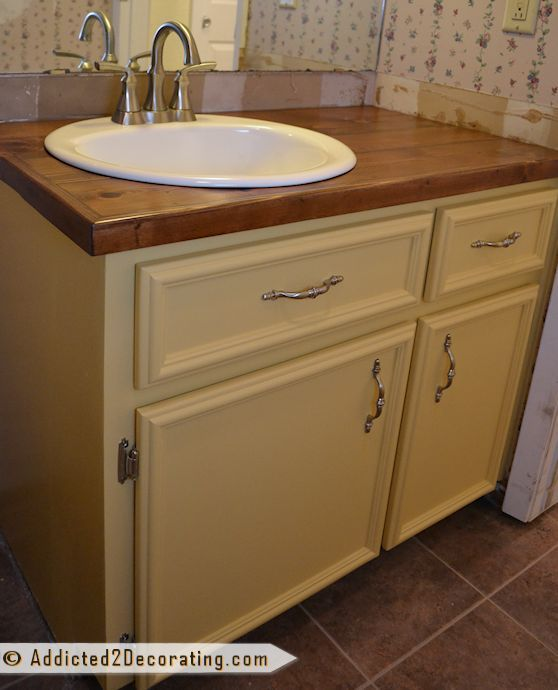 Vanity after makeover with new DIY doors and drawer fronts, and $35 wood countertop made from cedar fence pickets