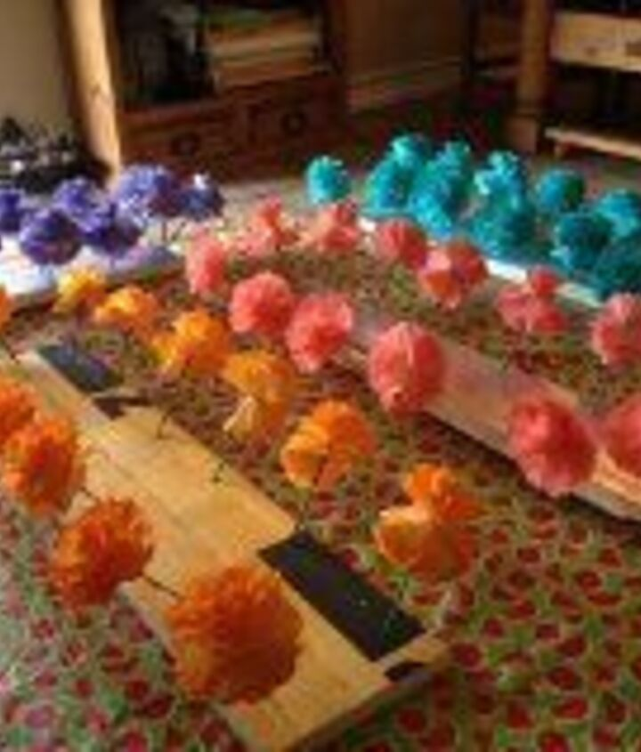 Dyed batches of flowers at a time. Stabbed the stems into insulation foam and spray dyed in large batches. Over 1000 flowers were made for this wedding