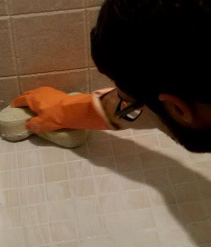 Use both the soft side and buff side of the grout sponge to clean off the epoxy grout.