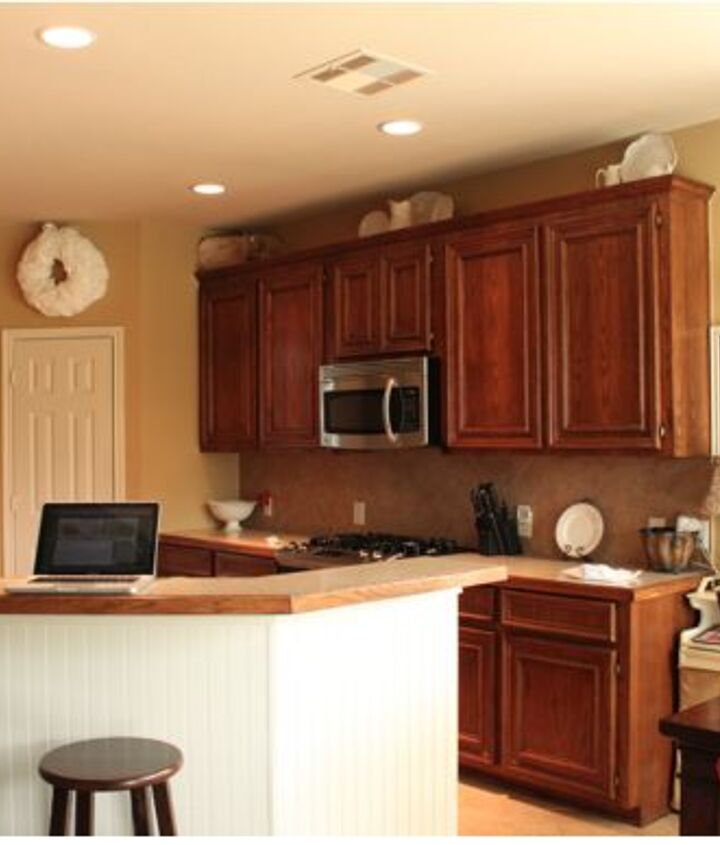 Kitchen before, with dark oak stained cabinets and laminate countertops that I was not a fan of.