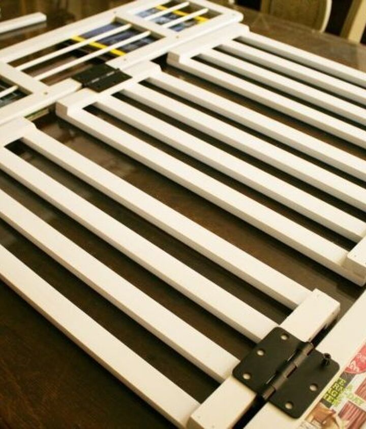 Bookcase pieces were transformed into a gate and attached using hinges.