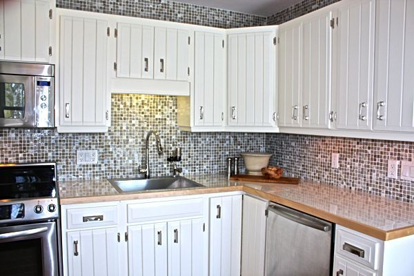 floor tiles as countertop.banded in maple. http://cynthiaweber.com/the-big-reveal-my-parents-new-kitchen/