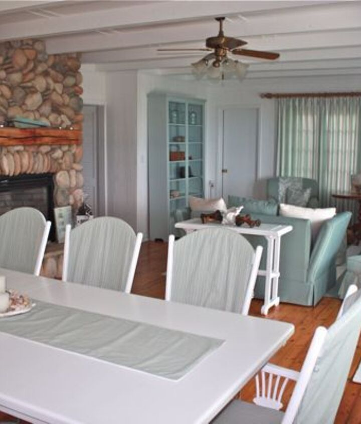 I used a large white and teal stripe for the drapes and a fine ticking stripe for slipcovers on the newly painted dining room suite.