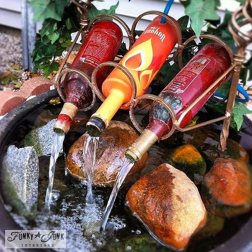 This quirky wine bottle water feature was shot in Ohio with my iPhone. http://www.funkyjunkinteriors.net/2013/02/i-want-to-make-water-fountain.html