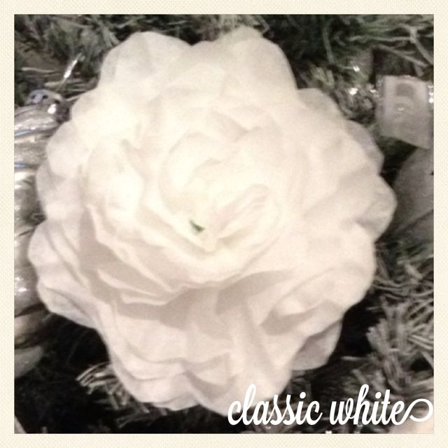 Classic White. This flower was originally made for a traditional wedding. Used here as decoration on my Christmas Tree.