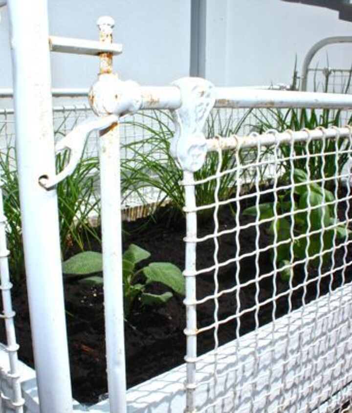 Detail of antique crib used for an herb garden