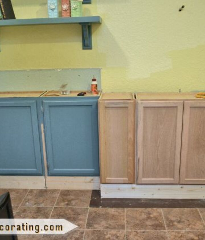 """I used stock wall cabinets (12"""" deep) from Home Depot as lower cabinets, so I had to build a base for them.  I was reusing some cabinets from a previous media wall attempt that didn't turn out so great, which is why they're painted."""