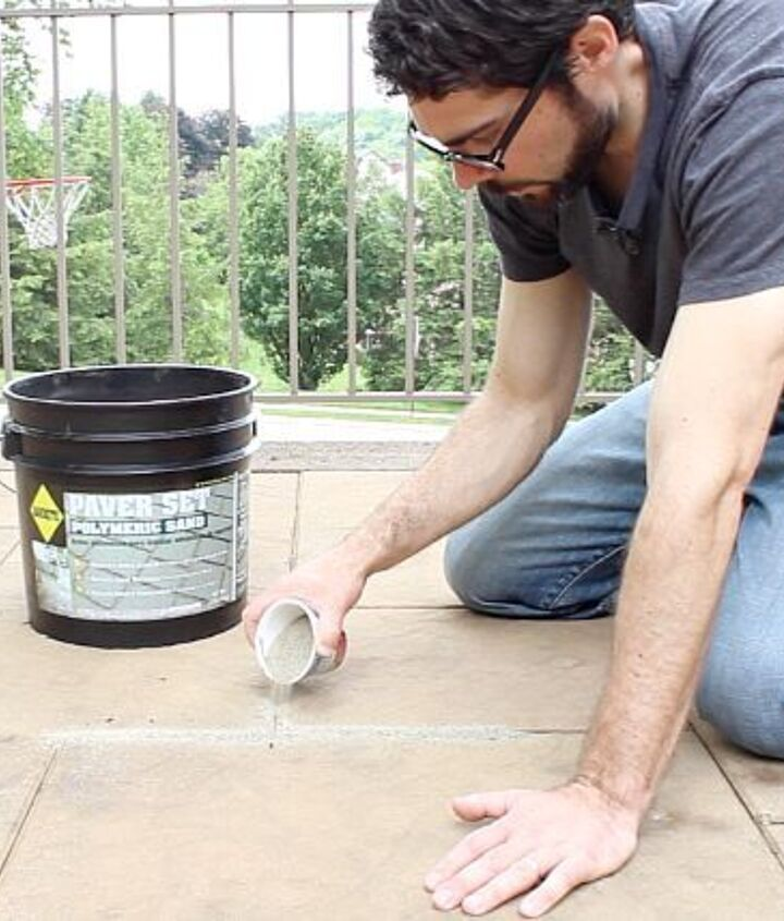 Spread polymeric sand onto your patio stones and brush it between them with a broom