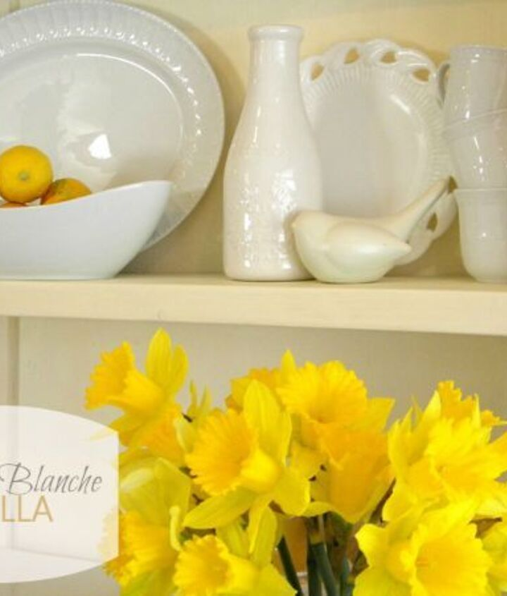 Several shades of white dishes and a few pops of yellow for Easter are sitting pretty on my hutch and making my dining room a much brighter and happier space.