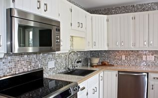 the big reveal a kitchen reno for my parents, diy, home decor, how to, kitchen backsplash, kitchen design, repurposing upcycling, We sanded and painted the existing cabinets I love how fresh and bright they are now The light reflecting backsplash tile adds sparkle and glam