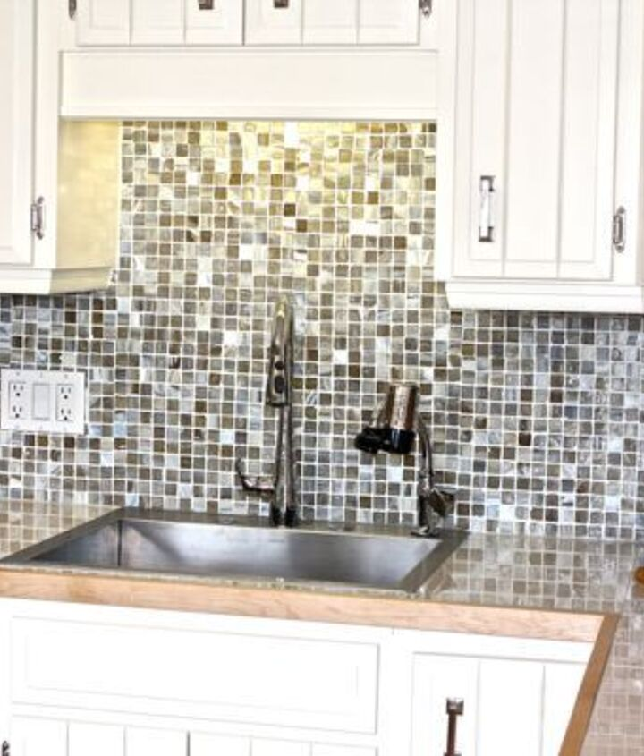 This beautiful Kohler sink is much more functional than what they had. The taps were repurposed from the old kitchen as they were in great shape. Counters were done with 12x24 floor tiles... a great option that is very cost effective.