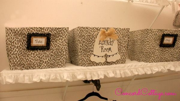 I covered plastic totes from Walmart w animal print fabric