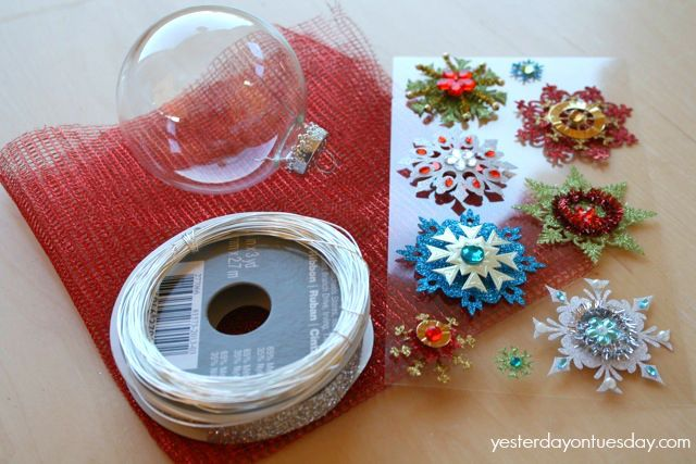 Supplies: A glass ball ornament, 12 x 12 mesh tulle square, a festive sticker, wire and thin (3/8) ribbon