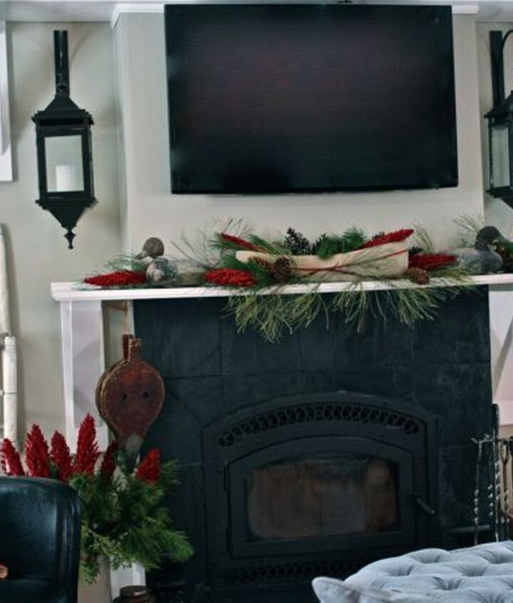 a rustic mantel and a cozy fire the family room at hoop top house decked out for, seasonal holiday d cor