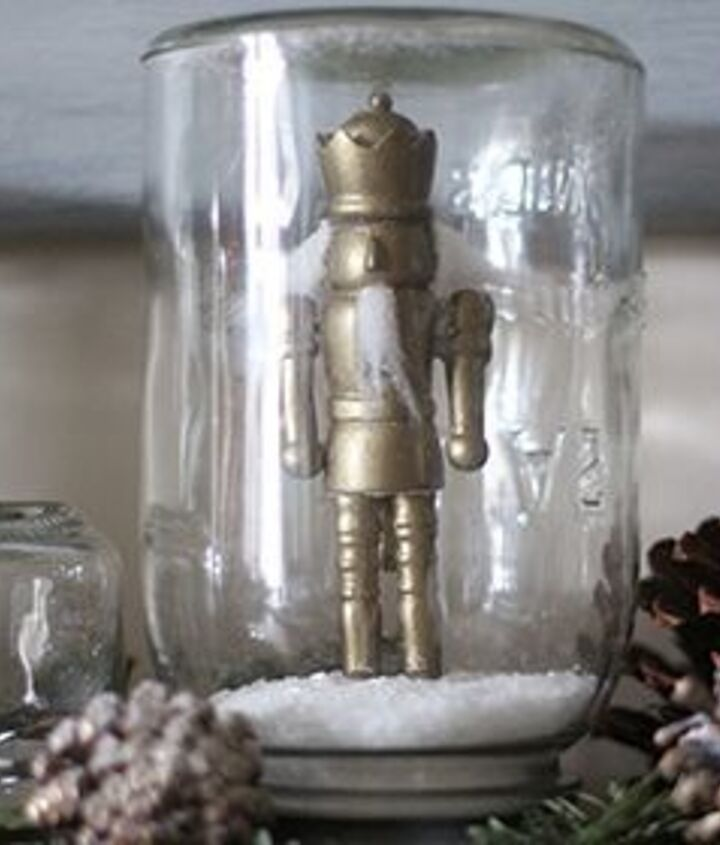 Nutcracker ornament painted gold and placed in a mason jar snowglobe