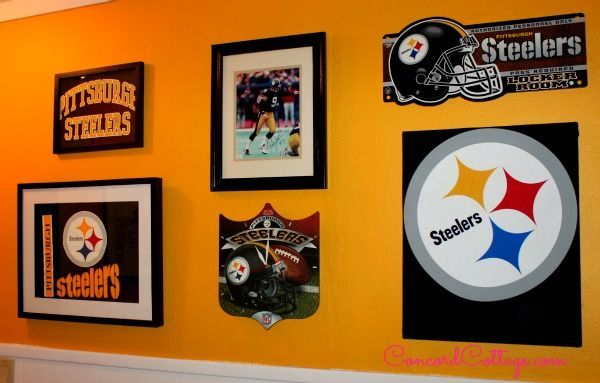 Our Gallery Wall we made with 3 T-shirts and frames we found at thrift stores and yard sales