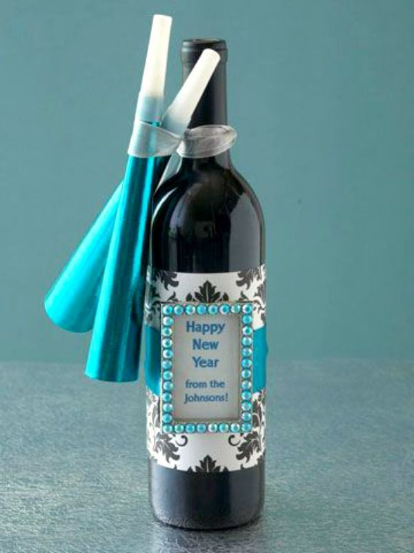 This is a great gift idea for your guests.  Wrap a bottle of wine or champagne and add a frame and some party favors with a Happy New Year wish from your family.  Source – Bhg.com.