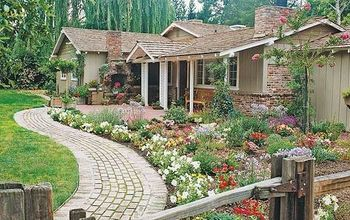 get spring ready add flowers to your front walk, flowers, gardening, landscape, Create more visual impact by using your plantings to accent a gently curving walkway BHG