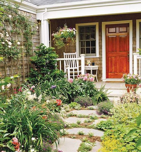 Embrace the front yard garden look by getting rid of your sidewalk and putting in loosely spaced flagstone - BHG