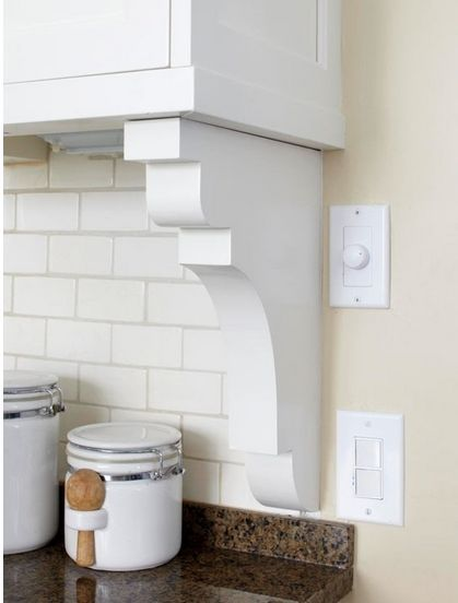 Transition backsplash to wall with a simple (and cheap!) shelf bracket.  opaldesigngroup.com