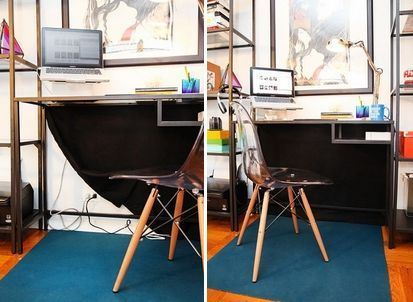 A black drop cloth can be utilized to hide cords, and make a simple (cheap) desk look more premium.