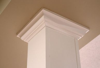 Basement or otherwise awkward middle-of-the-room boles can be turned into lovely columns with a little crown molding!  heyellowcapecod.com