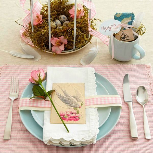 And how sweet is this tablescape using vintage notecards, birdcages, moss and eggs?? Love it.  It is also from Better Homes & Gardens.