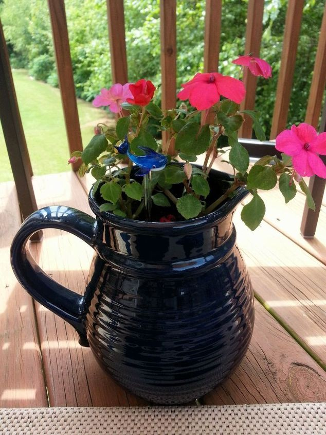 Impatiens in an old ceramic pitcher