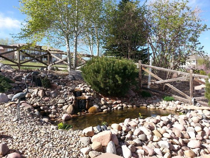 from a pile of cobbles to a beautiful pondless waterfall, landscape, outdoor living, perennial, ponds water features
