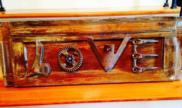 rustic love sign from old farm implement parts, crafts, repurposing upcycling