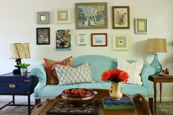 Tour a vintage eclectic living room decorated on a budget for Affordable living room decorating ideas