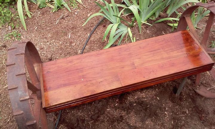 tractor wheel garden bench, outdoor furniture, outdoor living, repurposing upcycling