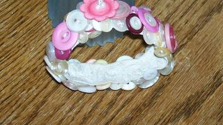 q what to do with old vintage buttons, crafts, repurposing upcycling, A bracelet I made
