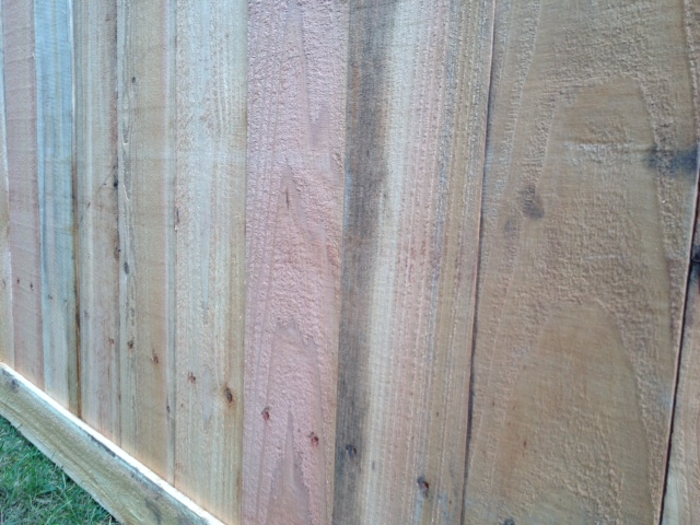 woodworking correcting poorly installed fence, fences, home maintenance repairs, how to, woodworking projects, Good nieghbor side of fence shows hail hole from bottom rail on inside of fence Rail was placed for another style of fence which probably would have hid these marks