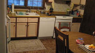 q kitchen design ideas strange layout help, doors, kitchen design, My daughter and her husband sanded and primed and painted the soft buff cream yellow on the cabinets