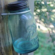 mason jar solar light on old oar, mason jars, outdoor living, repurposing upcycling