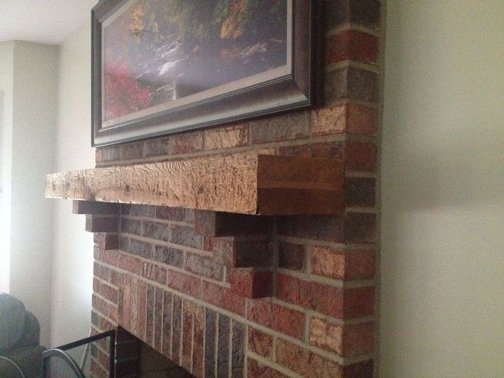 q mantel rustic fireplace ideas, fireplaces mantels, home decor, living room ideas, rustic furniture, It s very rough and has a brick piece sticking our to hold it up