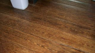 using old windows in your decor, home decor, repurposing upcycling, The kitchen floor done with heart pine