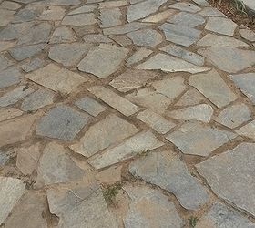 Flagstone On Slight A Lope Towards Patio With Sand Joints.