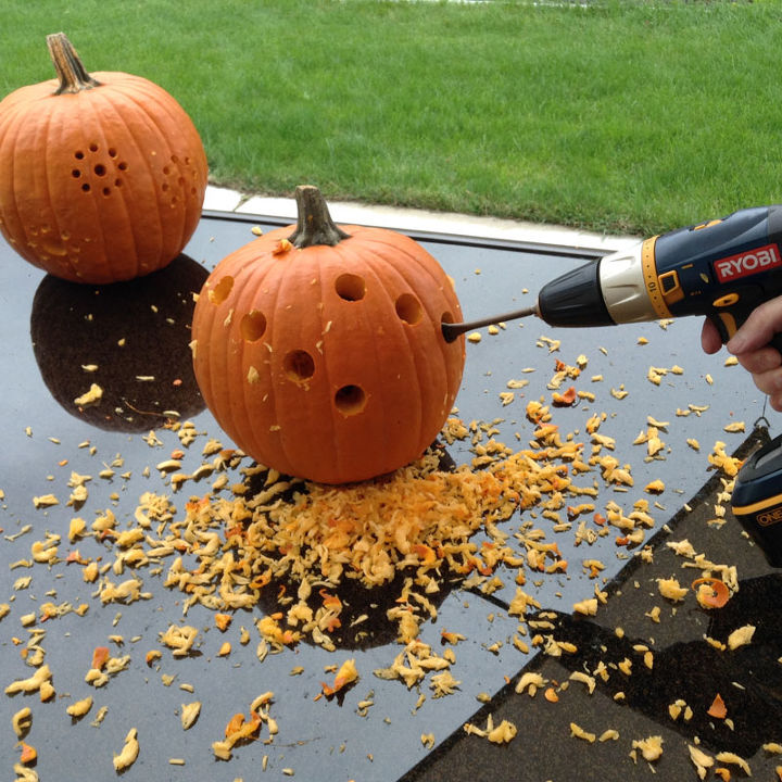 pumpkin carving with power drill, halloween decorations, seasonal holiday decor, tools