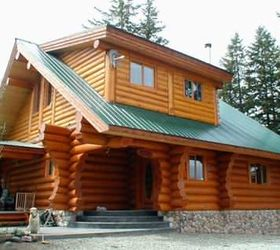 A Vertical Panel Metal Roof On A Rustic Log Cabin.