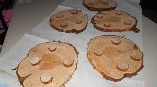 q tree slices, crafts, repurposing upcycling, Juniper trivets will nail gun the little feet to the bottom