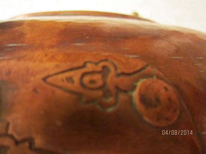 does anyone know what this pot is used for, markings engraved in the copper on the front by locking device