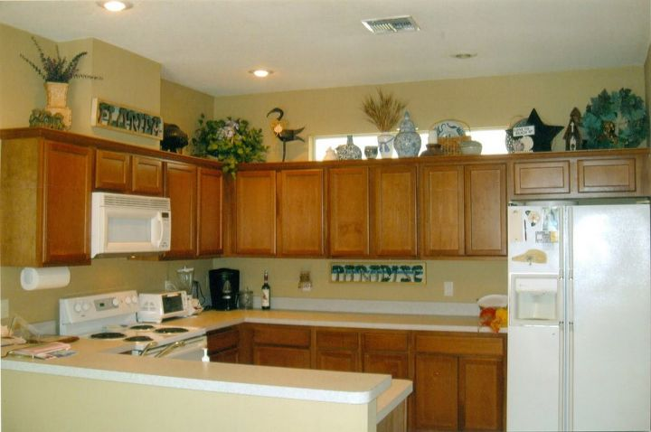 Methods for Using Above Kitchen Cabinet Decor Ideas | Hometalk on decorating top of kitchen cabinets, decor above kitchen sink, decor above refrigerators, decor above mantels, decor above windows, decor above kitchen table, decor above fireplaces,