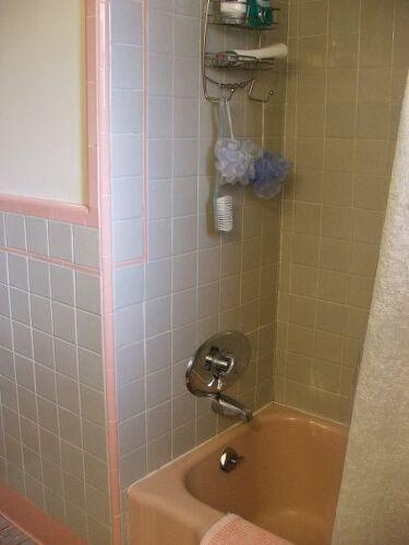 Pink tub, gray tile