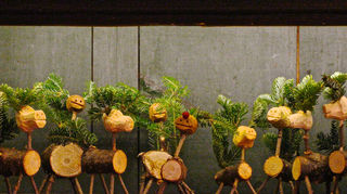 , Rudolph the red nosed reindeer made from Christmas tree trunks and branches stands alongside other reindeer made from Christmas tree trunks